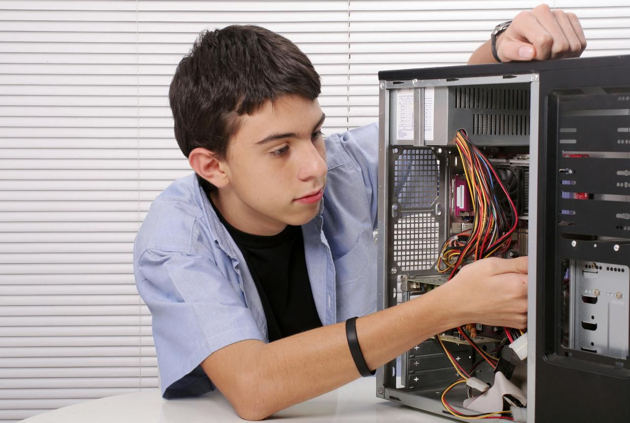 Teenager fixing a computer