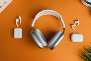 Apple AirPods, Pro, and Max on orange table