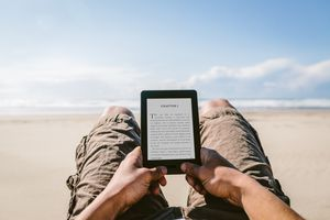 Person in desert reading a Kindle