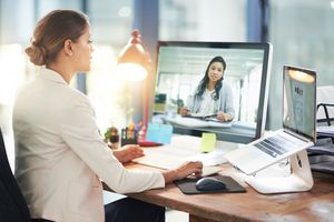 Image of a woman using two computer screens