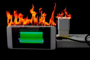 smartphone and charger on fire