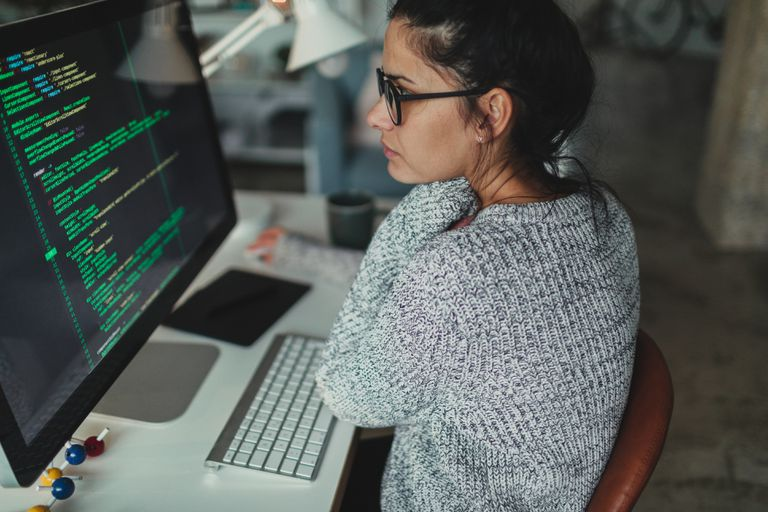Young woman programming at her home office