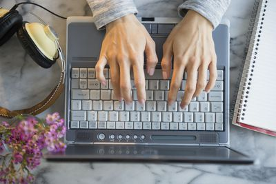 Mixed race woman using laptop for typing lessons