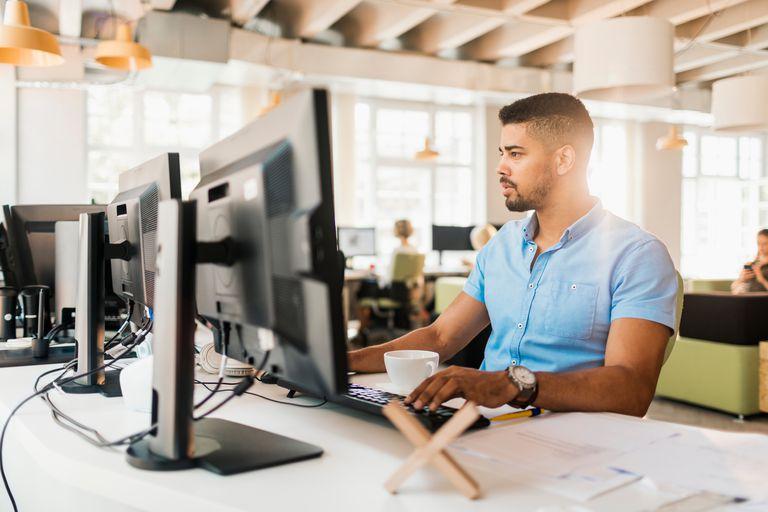 Web developer working at desk.