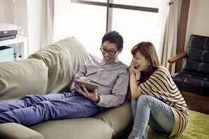 Young couple is relaxing in the room