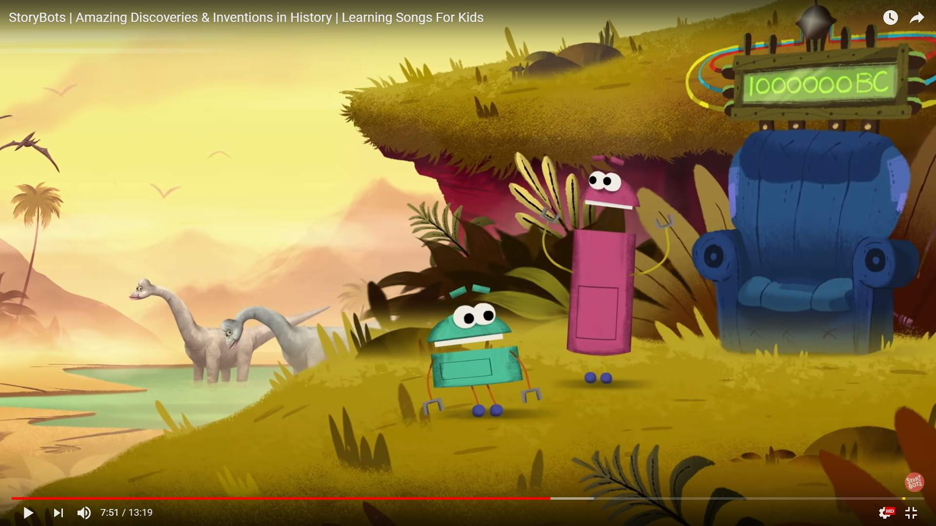 Screenshot from StoryBots showing two robots with dinosaurs and an easy chair in the background