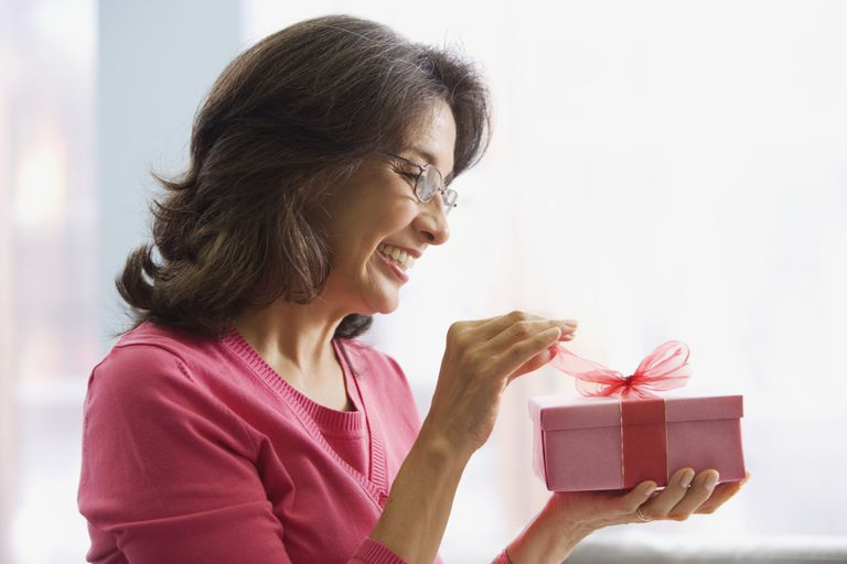 Mother opening a gift