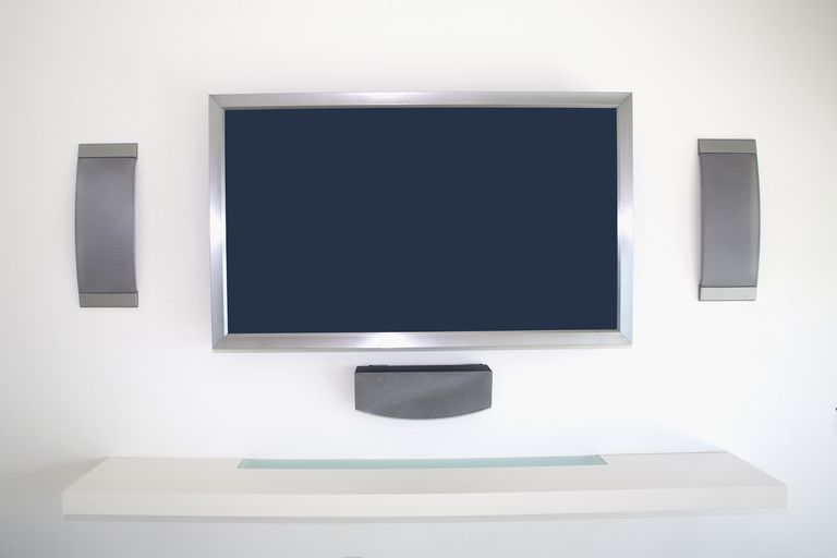 A Home Theater Setup With In Wall Speakers