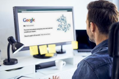 A man looks at a Google Drive error message on his computer.