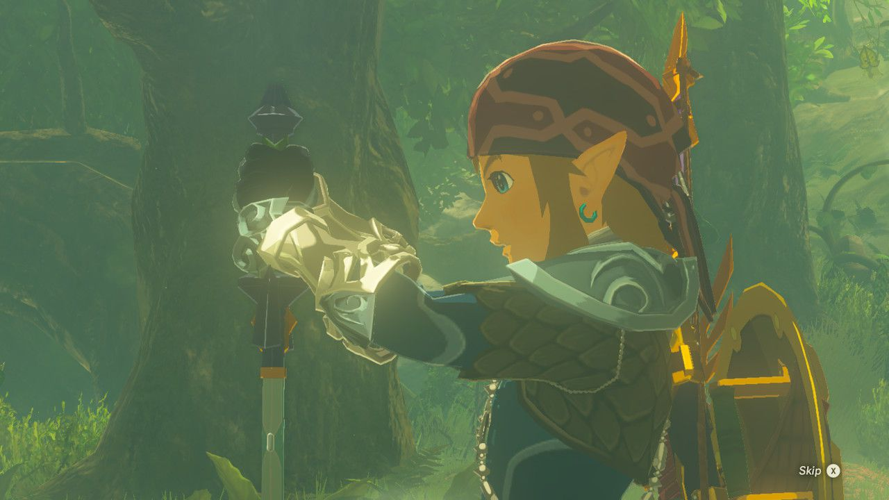 Pulling the Master Sword from its pedestal in The Legend of Zelda: Breath of the Wild.