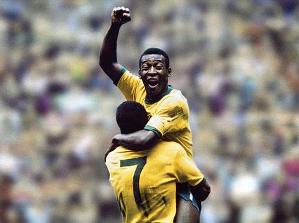 Pelé the soccor player raises fist in triumph in Pelé 2021