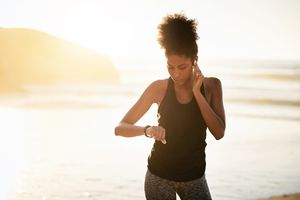 Woman using airpods and watch while exercising