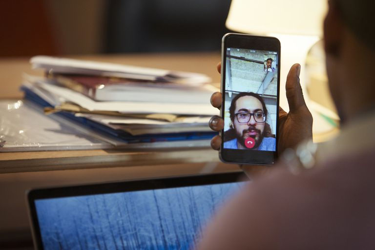 A person having a FaceTime conversation on an iPhone
