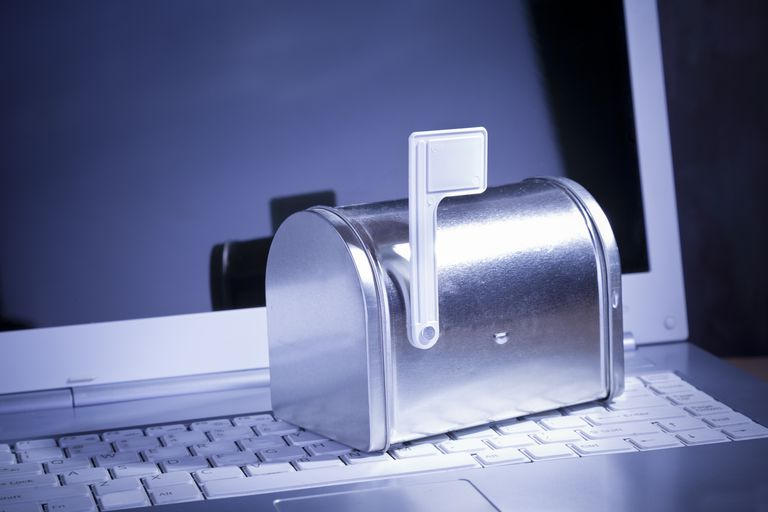 You've Got Mail. Miniature silver mailbox on white laptop.