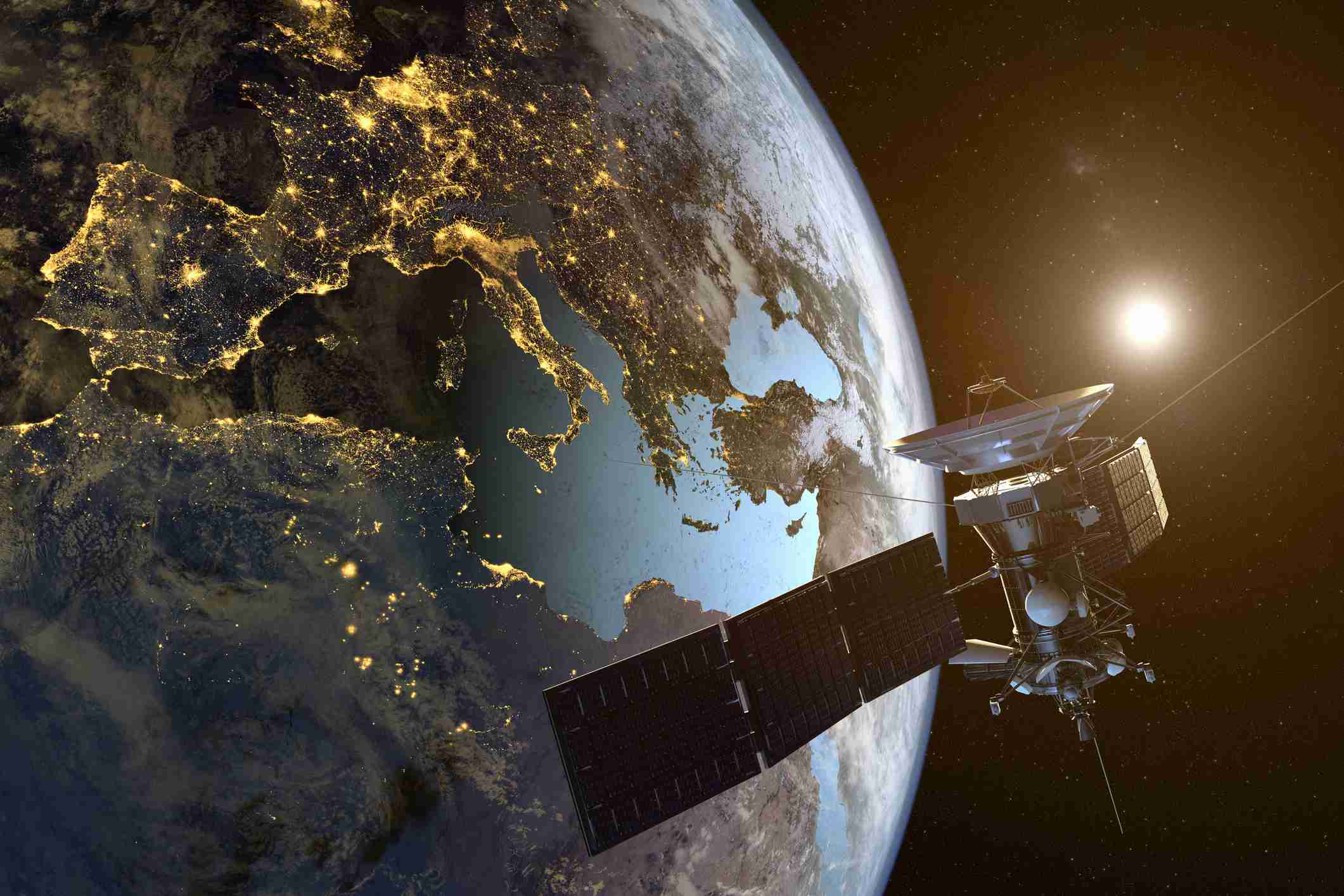 A satellite is shown in space orbiting the earth