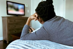 Woman watching TV from the back
