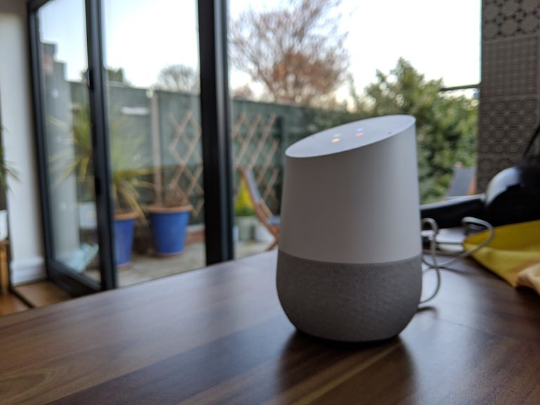 Google Home speaker on kitchen table
