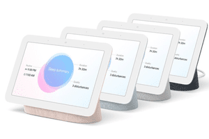Four Google Nest Hubs placed in a row