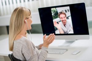 Woman and friend using Skype