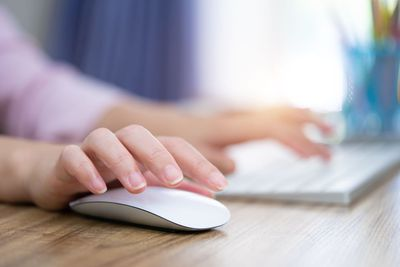 Image of a woman using a mouse