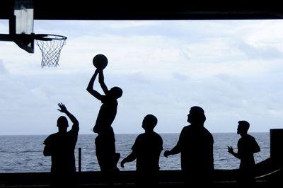 People playing basketball outside.