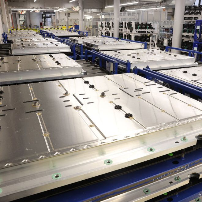 VW production facility showing numerous EV batteries ready to use in new vehicles.
