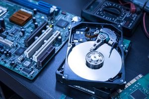 Inside of hard disk drive on a technician's desk