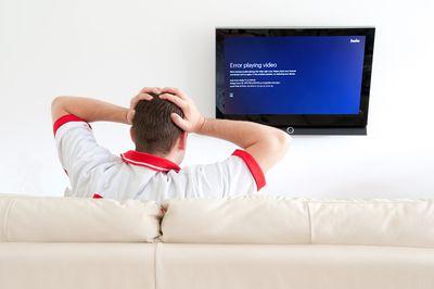 A man views Hulu error code PLAUNK65 on his television.