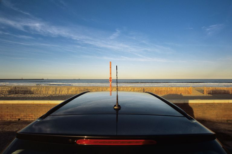 Supercar at the beach - Sunset sky copyspace