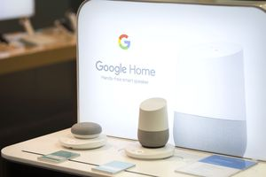 A Google Home and Google Home Mini on display in a store