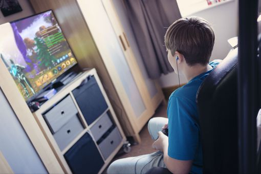 A boy plays Fortnite: Save the World