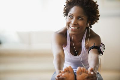 Woman Stretching Listening to Music