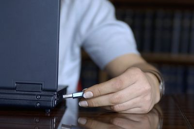 Inserting a portable USB hard drive into a laptop