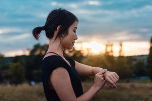 A woman in sportswear looking at her smartwatch