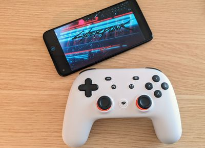 A Stadia controller connected to a phone playing Cyberpink 2077.