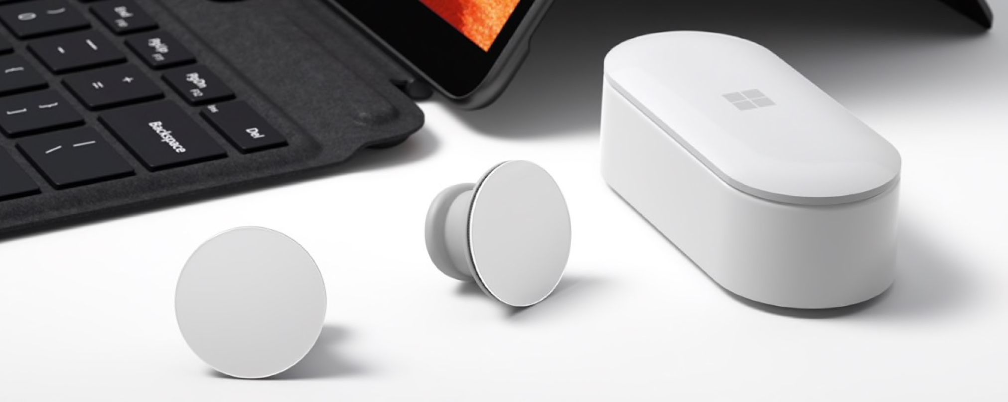 Microsoft's Surface Earbuds outside of case on a table.