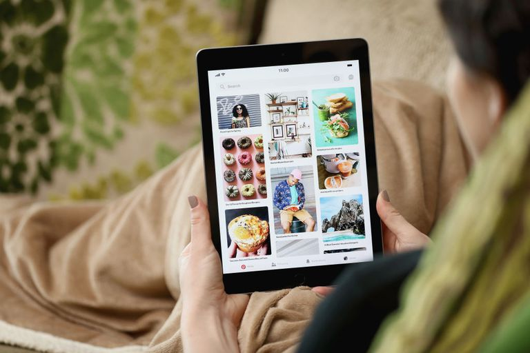 Person using pinterest on ipad on couch