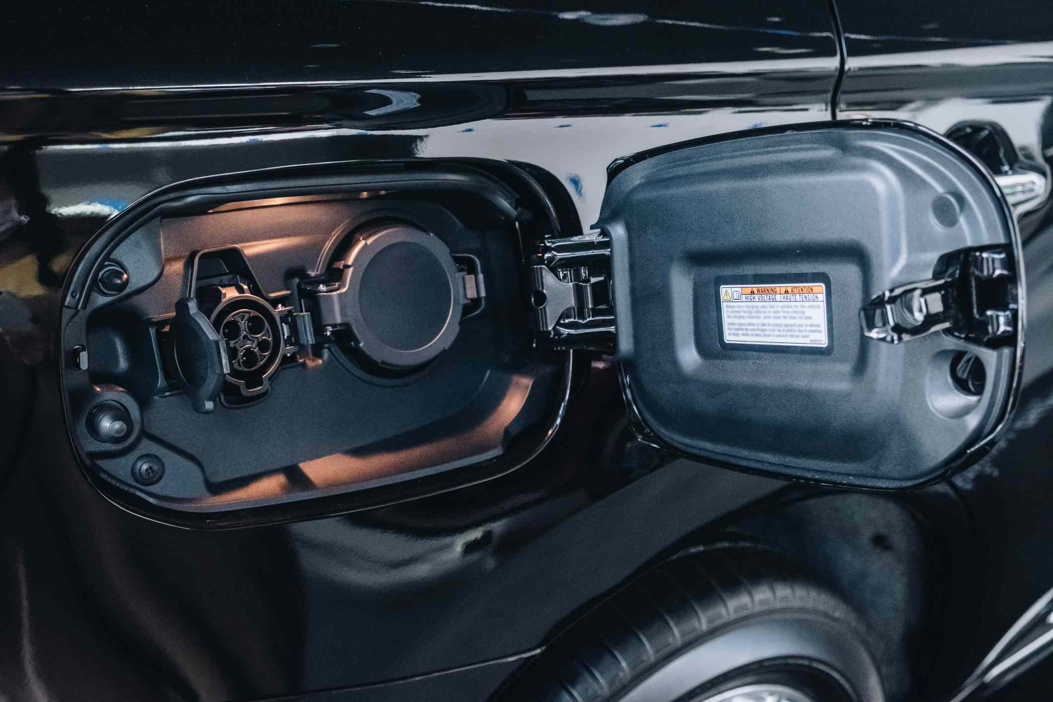 Close up of plug-in hybrid port of an Hybrid Electric Vehicle (PHEV).