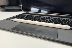 A closeup of the Apple Pencil sitting on a Magic Keyboard with the iPad mounted behind it.