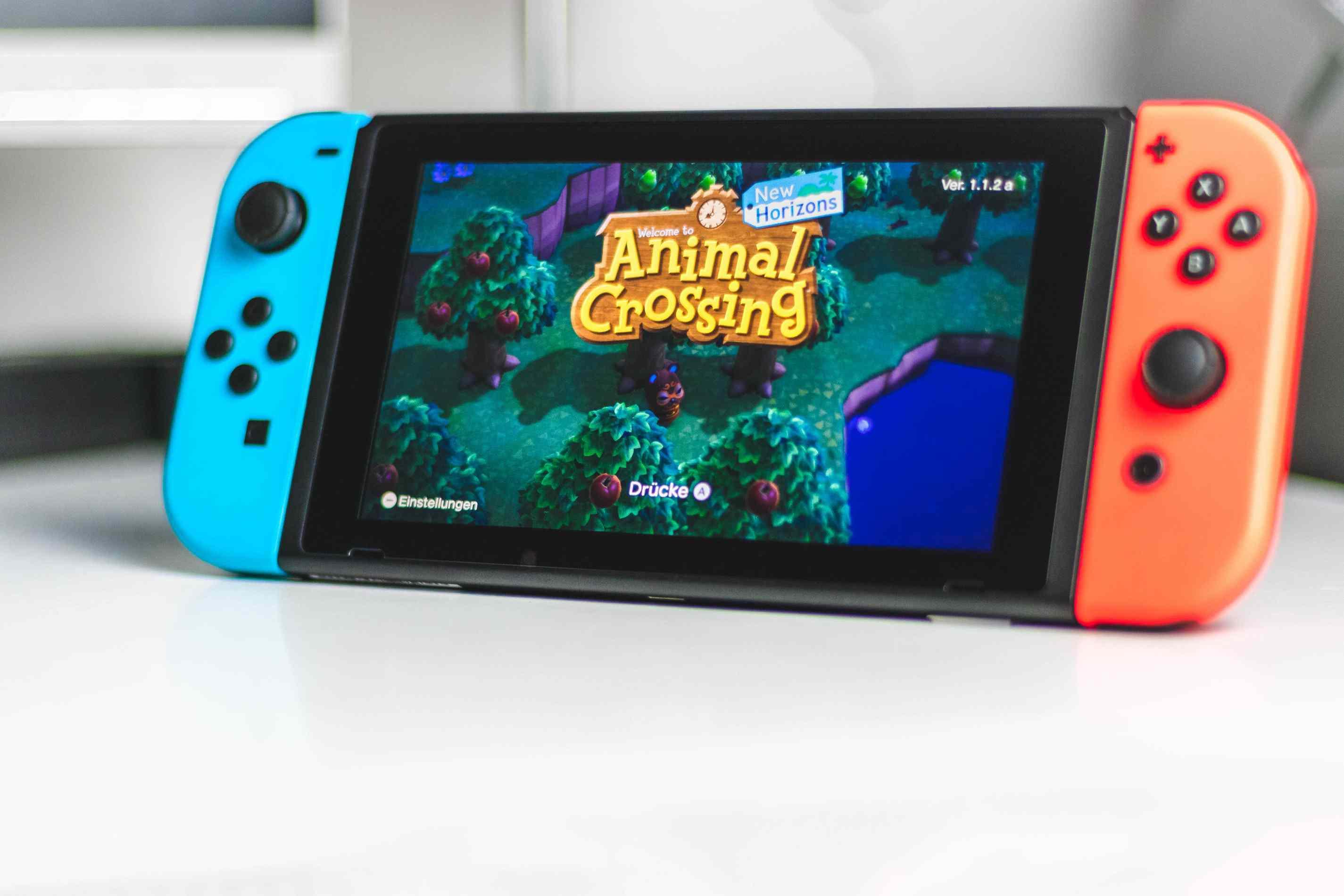 Nintendo Switch standing with kickstand and running Animal Crossing: New Horizons