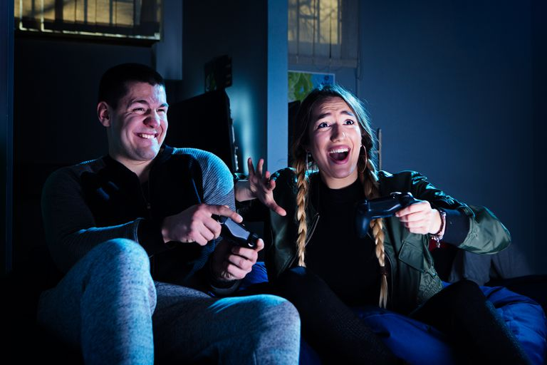Happy couple playing video games.