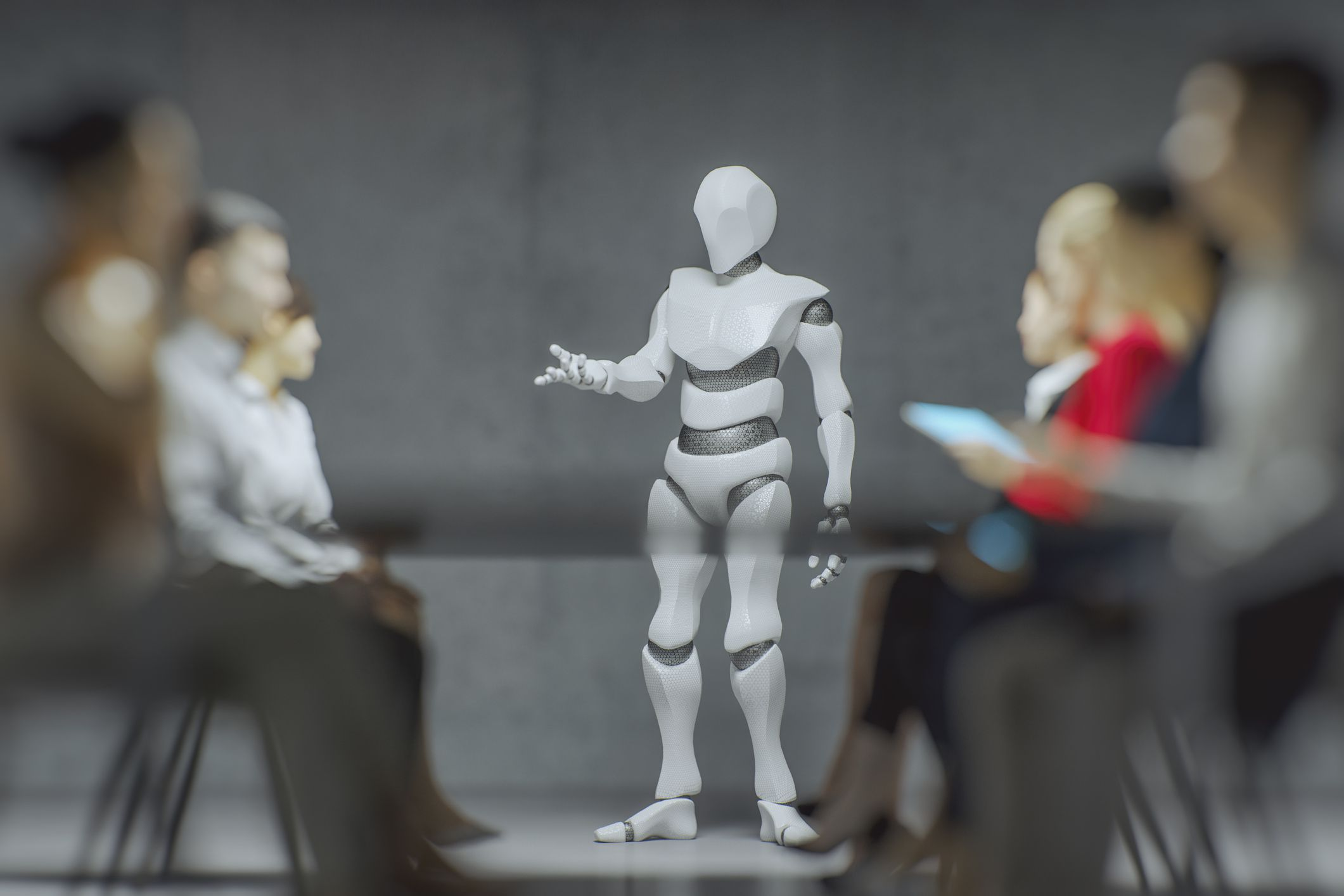 Humanoid robot talking to a group of people.