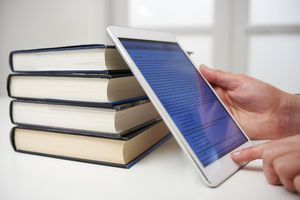 Picture of books and a tablet with an ebook