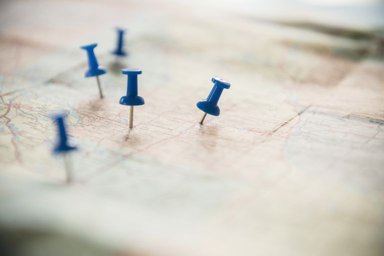 Close up of pushpins on roadmap route
