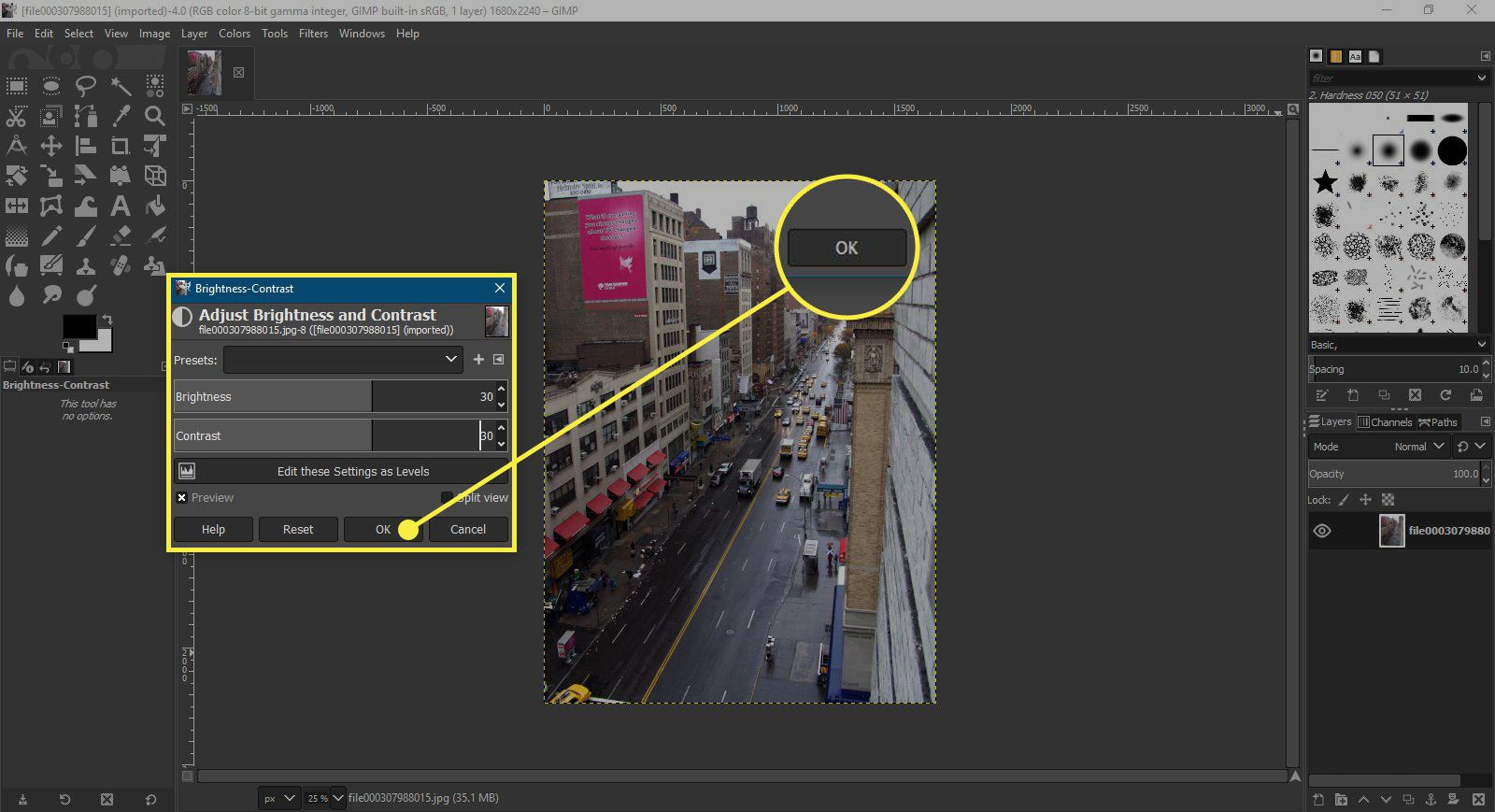 A screenshot of GIMP's Brightness/Contrast window with the OK button highlighted