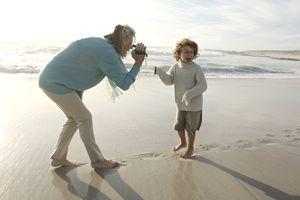 A grandparent filming a grandchild