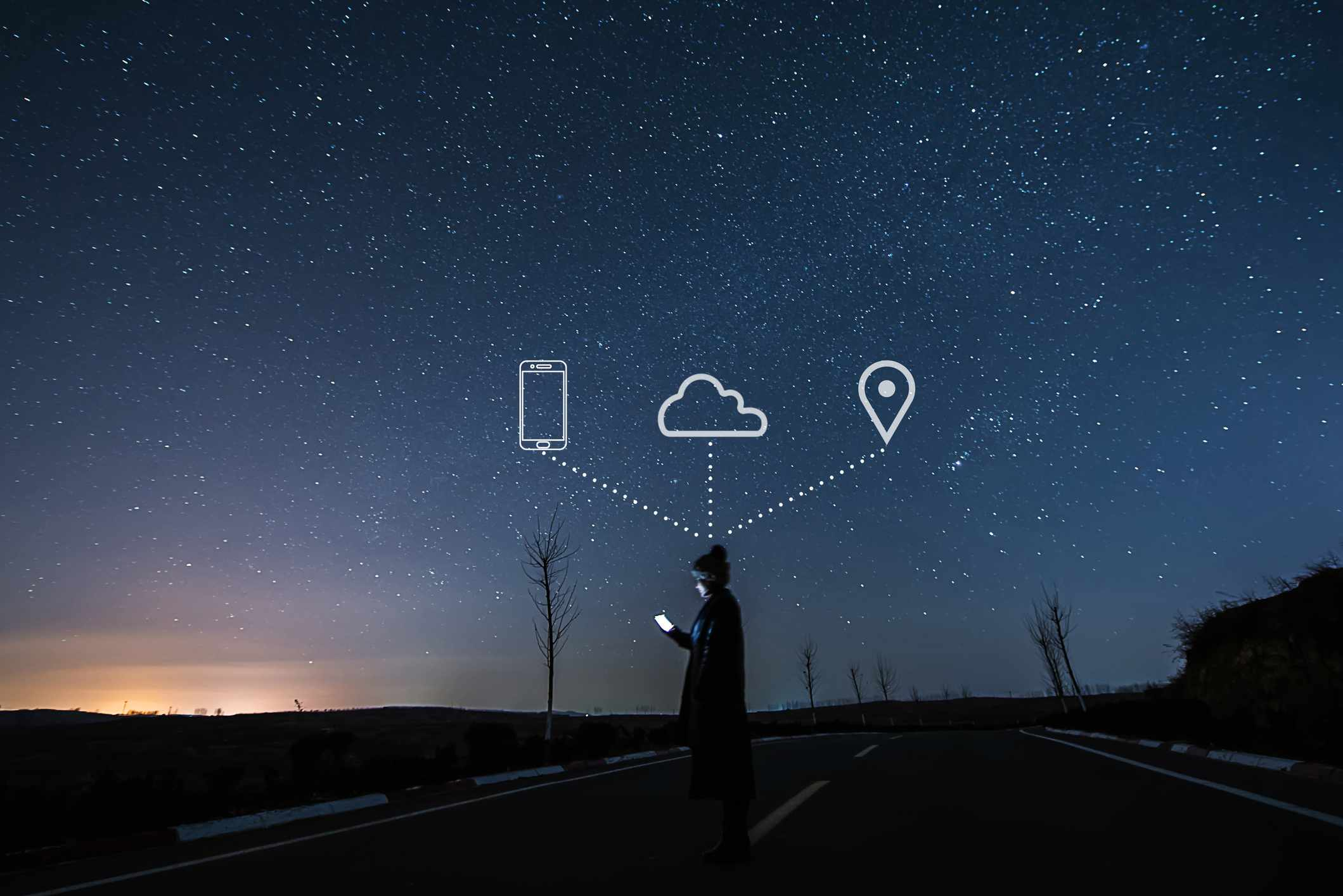 Someone using a smartphone on a starry night, with phone, cloud, and map icons in the sky above.