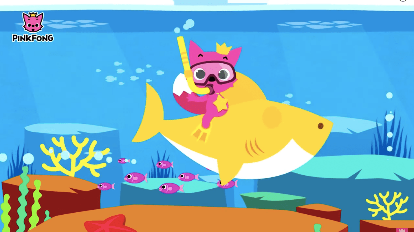 A pink fox rides a yellow baby shark underwater.