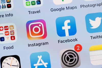 Instagram and Facebook app icons on a smartphone