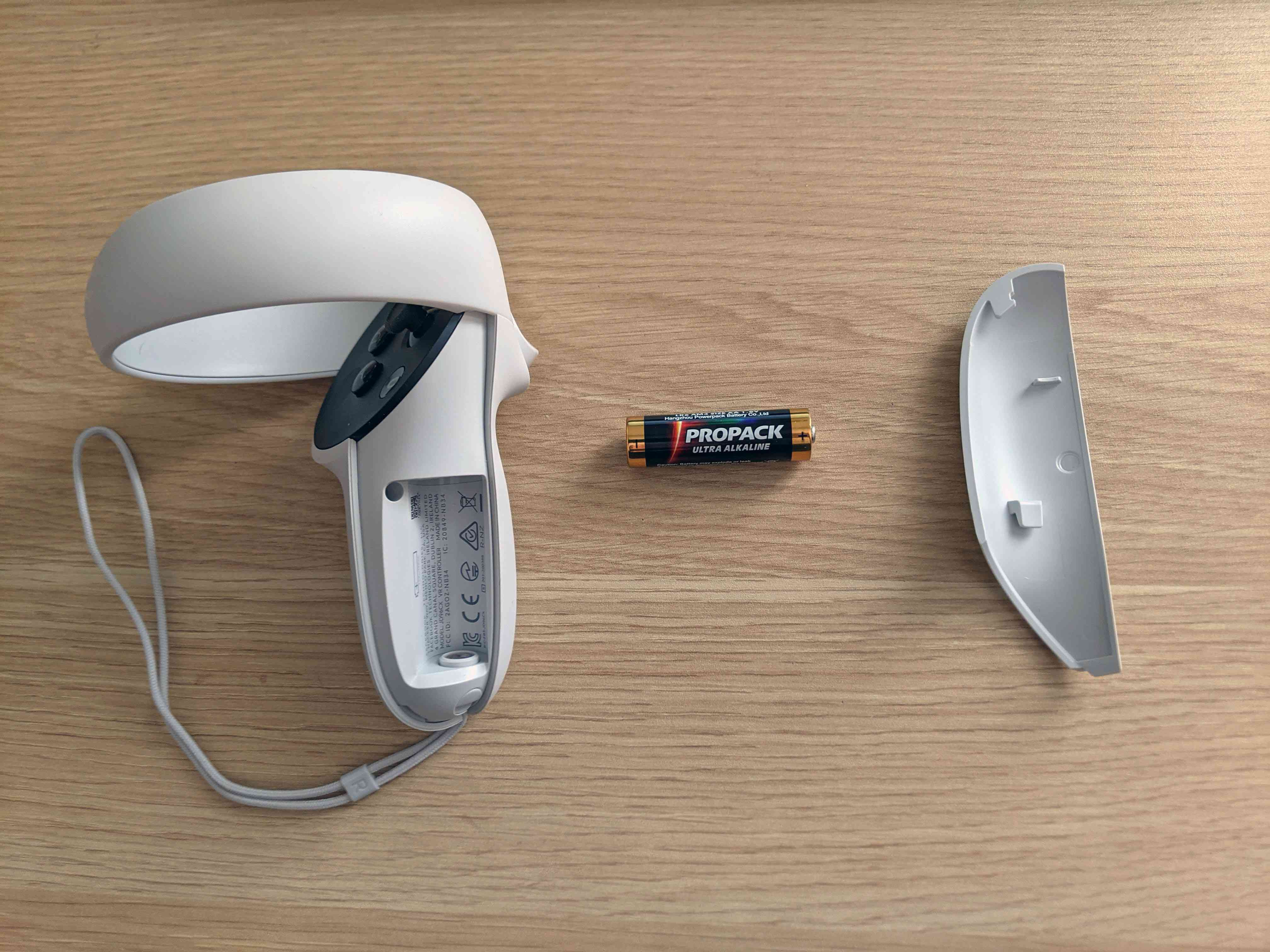 An Oculus Quest 2 controller with the battery removed.